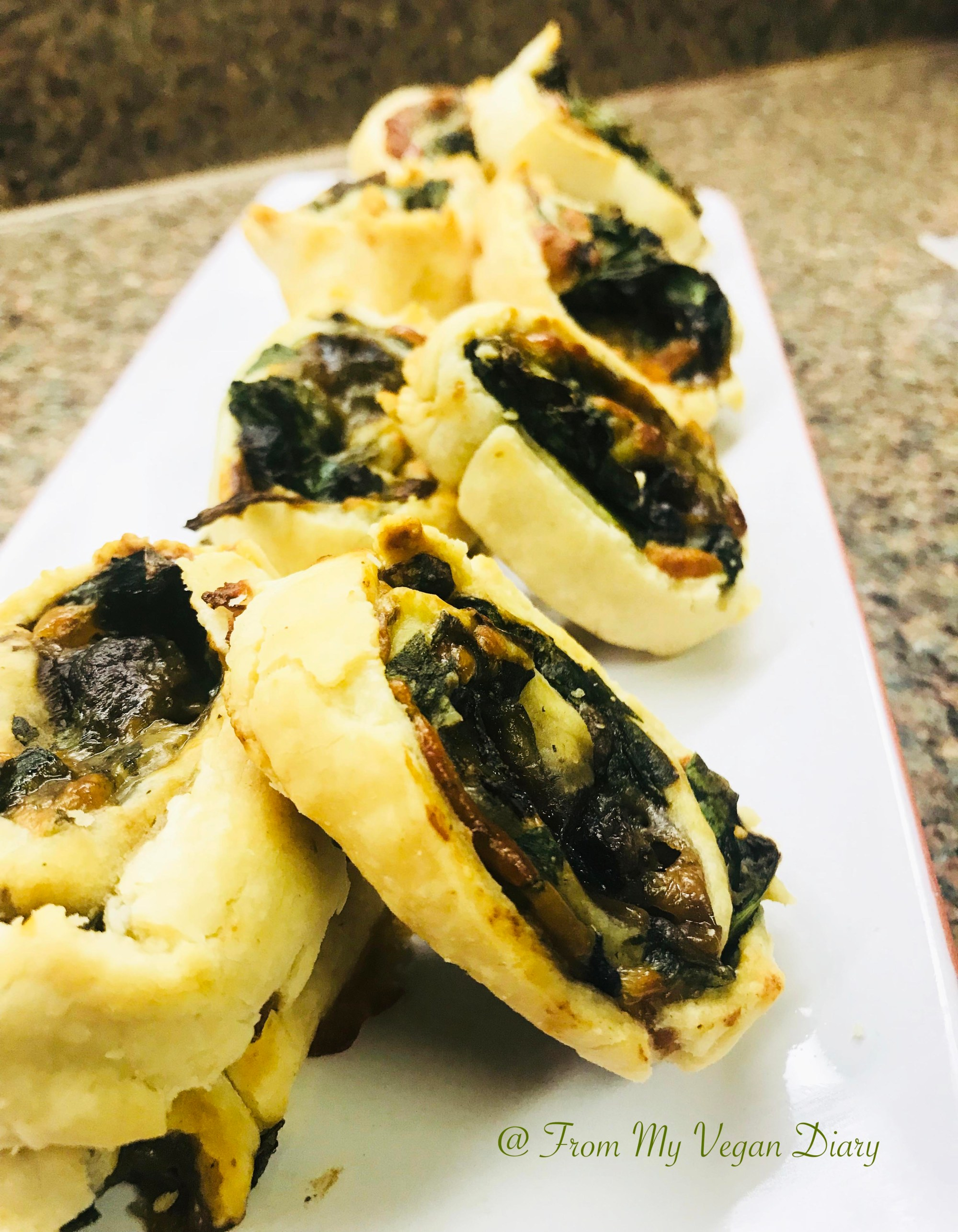 Vegan Spinach and Cream Chesse Pinwheel Recipe on a white plate
