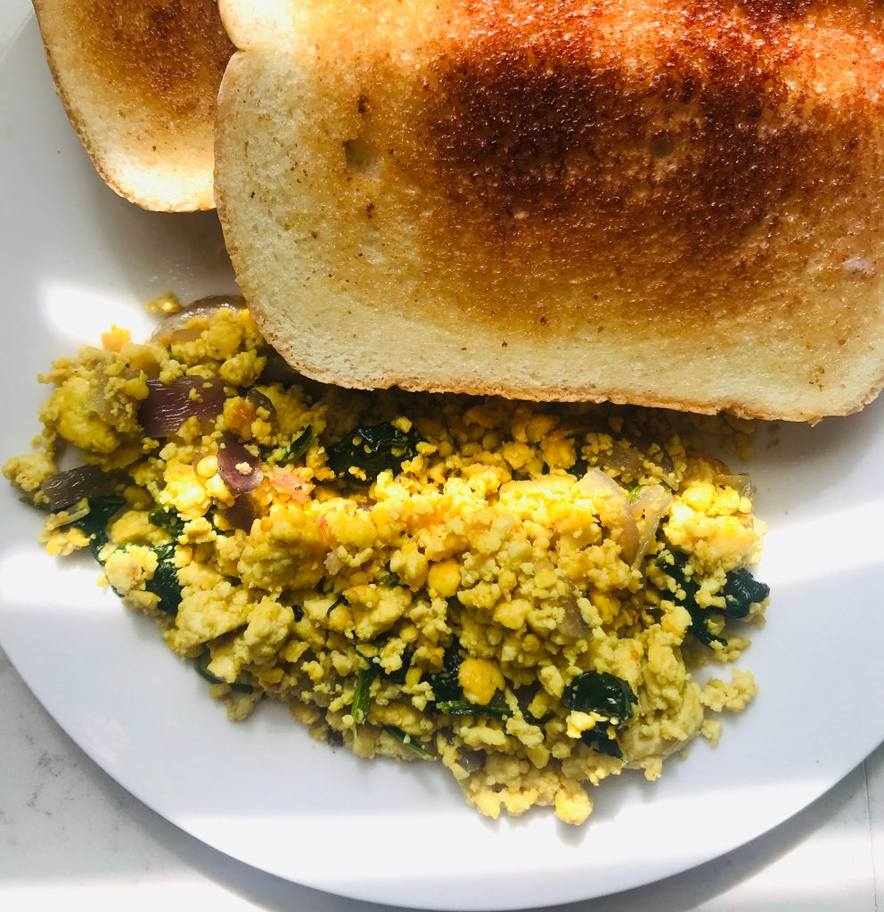 Scrambled tofu with buttered bread toast